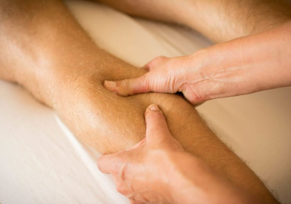 Sports massage to the left calf
